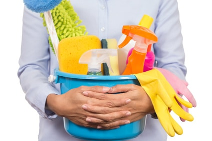 woman with cleaning supplies in a bucket