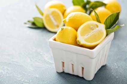 lemons in a fruit storage container