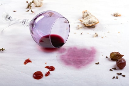 red wine spilled on a white table cloth