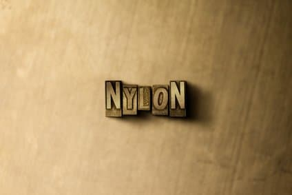 the word nylon with a wooden back drop