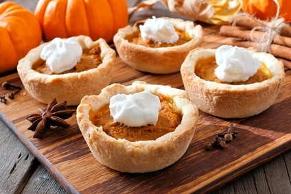 small individual pumpkin pies with whipped cream