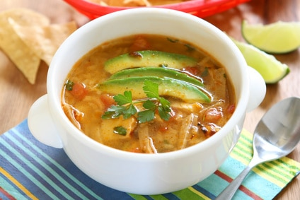 tortilla soup in a white bowl