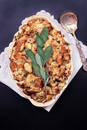 Plate of stuffing with silver serving spoon