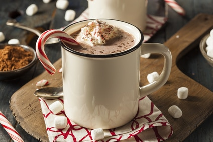 Hot chocolate with candy cane in a mug