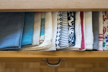 towels in a brown drawer