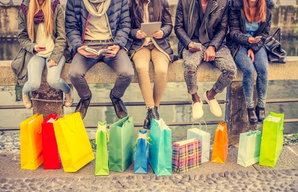 group of shoppers sitting on a wall