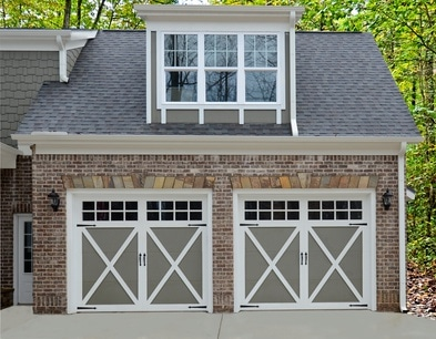 barn door garage with a roof