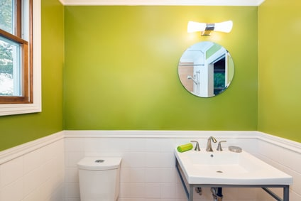 Green bathroom with toilet and sink